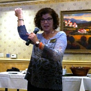 """Debbie Merion accidentally giving herself the finger, while explaining at WXW """"Say It and Show it"""" how to thwart the editor in your elbow who squelches your creativity."""